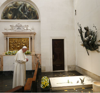 Pope Francis prays at the tomb of Fatima seer Francisco Marto before celebrating the canonization Mass for him and his sister, Jacinta Marto, at the Shrine of Our Lady of Fatima in Portugal, May 13. (CNS photo/Paul Haring)