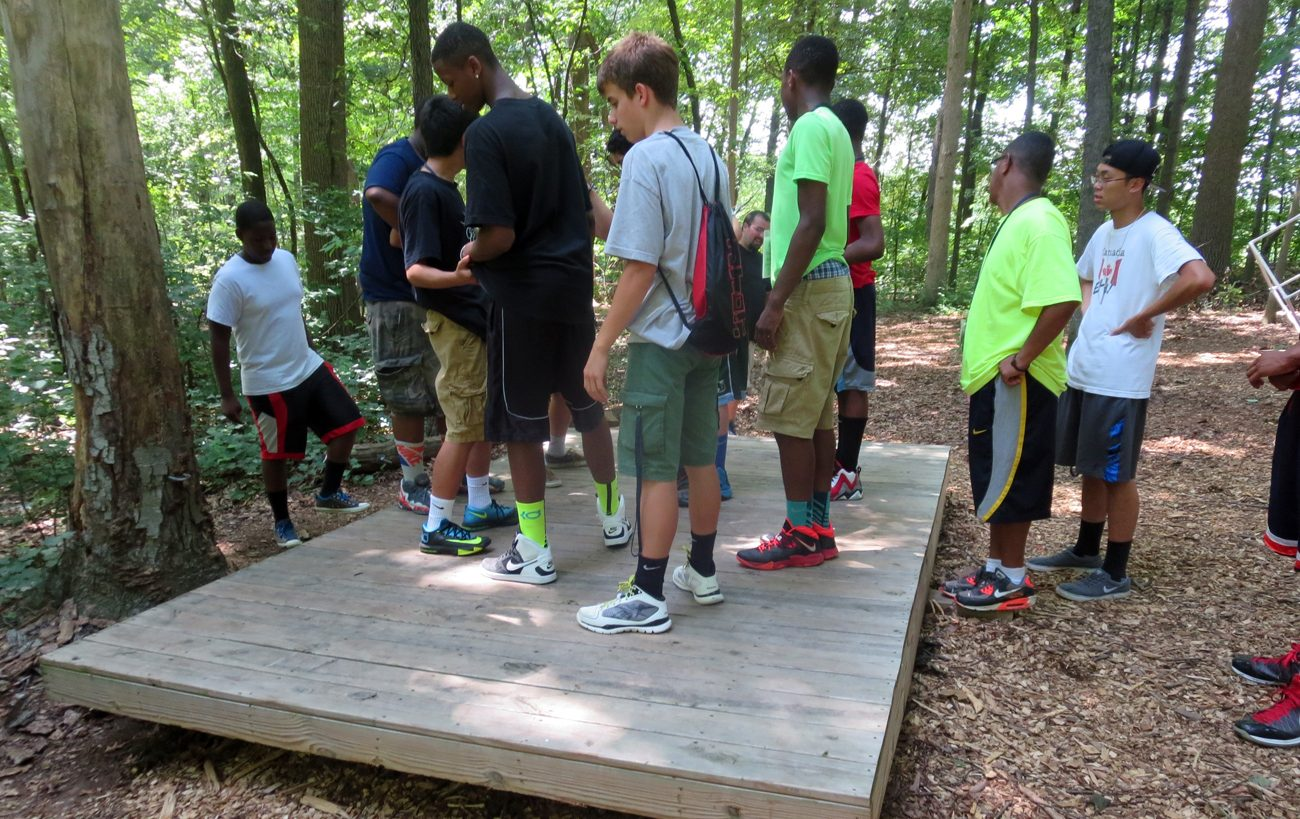 Teens at a previous Quo Vadis retreat get ready to go on a hike in the woods of Black Rock Retreat Center in Lancaster County.