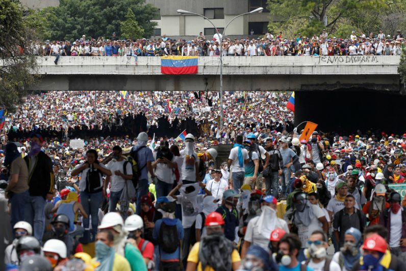 Demonstrators rally against Venezuelan President Nicolas Maduro in Caracas, Venezuela, May 3. Two days later, Pope Francis urged the country's bishops to remain close to the poor and needy. (CNS photo/Carlos Garcia Rawlins, Reuters)
