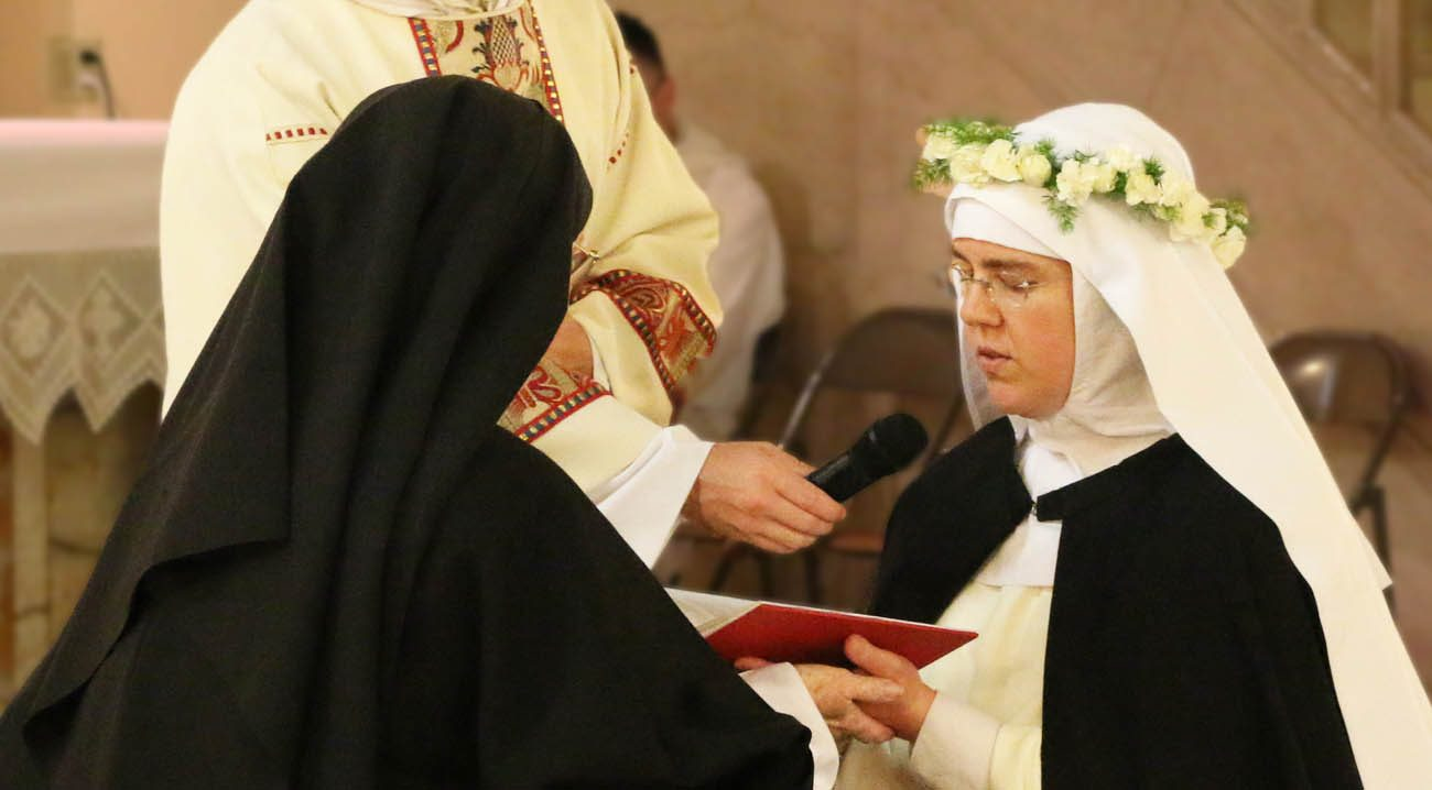 Sister Marie Dominic, right, professes her first vows as a cloistered nun May 28 at Corpus Christi Monastery in Menlo Park, Calif. Sister Marie Dominic was an attorney and an evangelical Christian in Anchorage, Alaska, who joined the Catholic Church during her last months of law school. (CNS photo/courtesy Sister Marie Dominic)