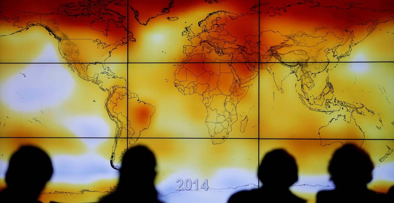Participants look at a screen showing a world map with climate anomalies during the World Climate Change Conference at Le Bourge, France, in this Dec. 8, 2015, file photo. Bishop Oscar Cantu of Las Cruces, New Mexico, chairman of the U.S. bishops' international justice and peace committee, said in a June 1 statement President Donald Trump must honor the nation's commitment to the Paris agreement to protect the planet. (CNS photo/Stephane Mahe, Reuters)