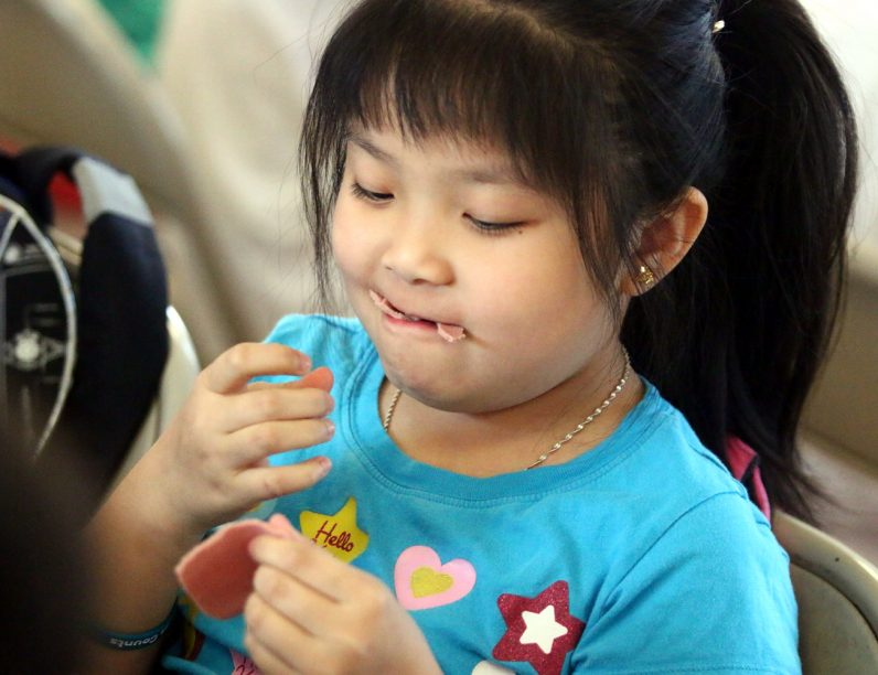 Kelly Jin creativly eats her lunch.