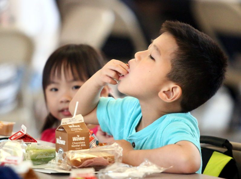 Henry Liu enjoys his meal at Holy Redeemer Camp.