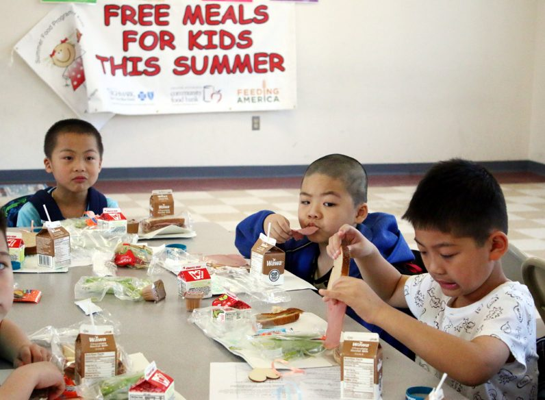 Jaeden Chen, Jack Wong, and Lanson Chen enjoy lunch provided through the NDS Summer Meals Program.