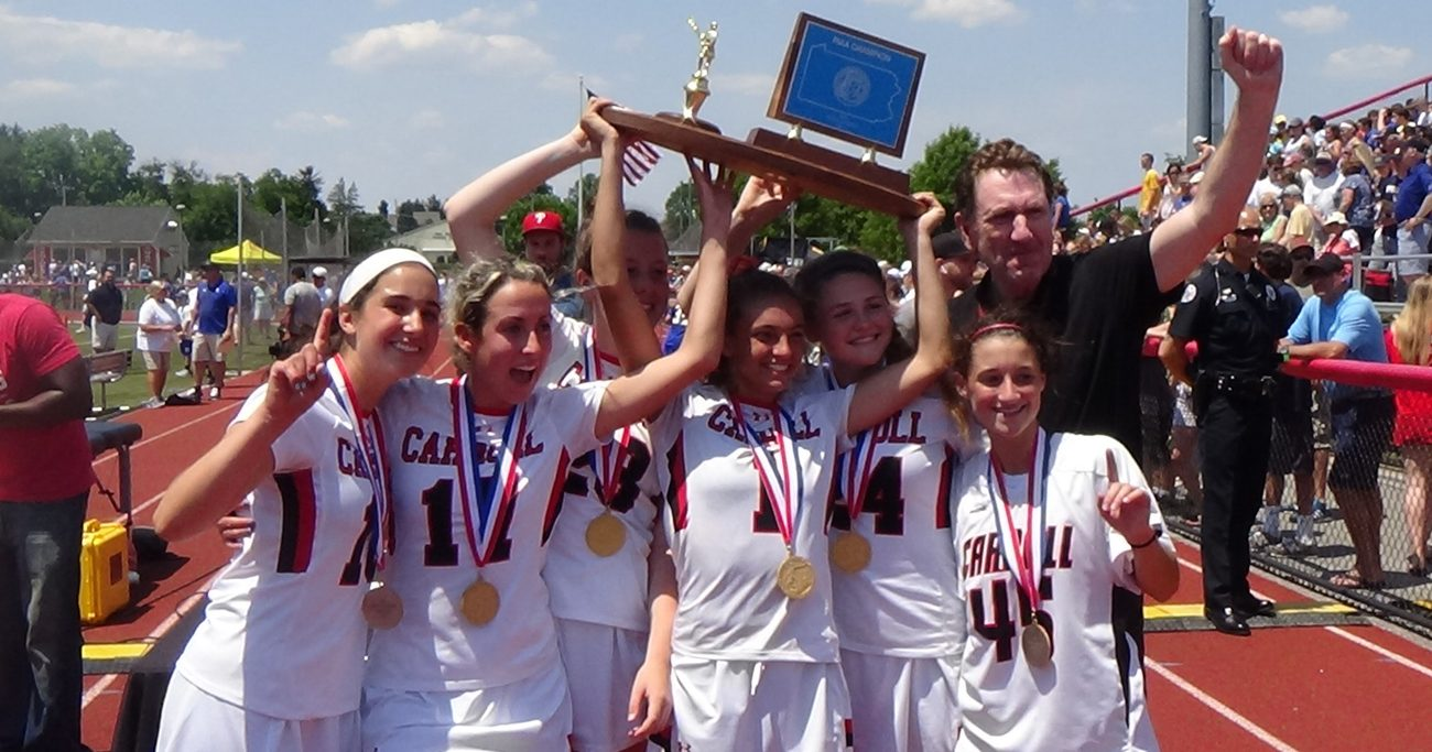 The ladies of Archbishop Carroll High School hoist the championship plaque June 10 at West Chester East High School, following their 9-8 win over Springfield (Delco). (John Knebels)