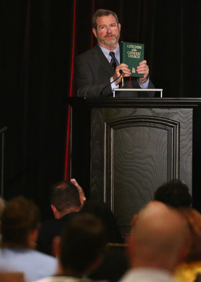The Tradition conference's keynote speaker Jeff Cavins explains the catechism to the attentive audience. (Sarah Webb)