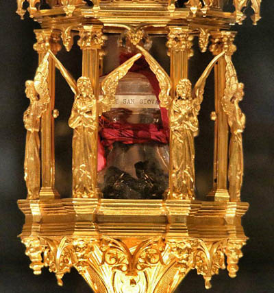 A reliquary holding a glass jar containing a relic of St. John Bosco is shown in this file photo. The relic, a piece of the saint's brain, was stolen June 2 from the Basilica of St. John Bosco in Castelnuovo Don Bosco, Italy, and recovered June 15 by police. (CNS photo courtesy of the Salesians and Andrea Cherchi)