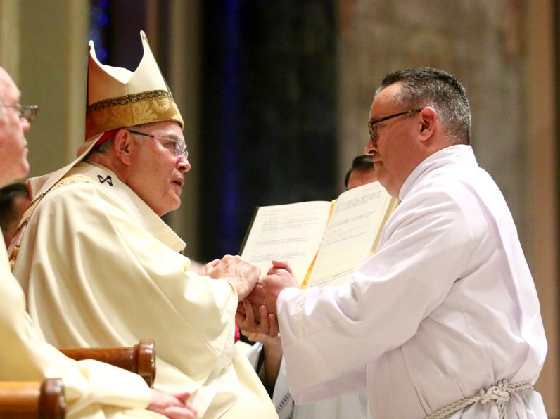 Justin J. Watkins makes his diaconate promise.
