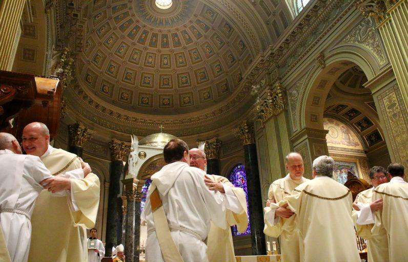 From left, Deacons Daniel E. Mazurek, John R. Bowie, John P. Pfeifer and Michael J. Cushing receive congratulations from their fellow deacons.