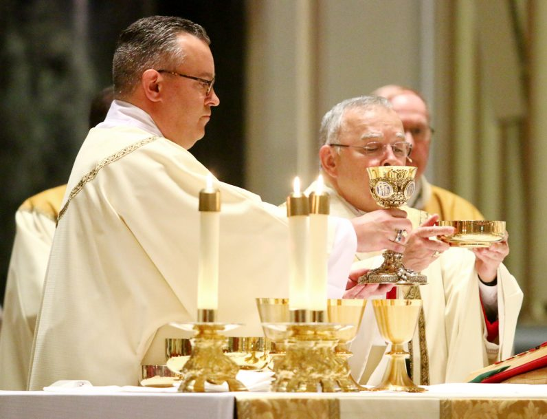 Newly ordained Deacon Justin J. Watkins serves as deacon of the Eucharist.