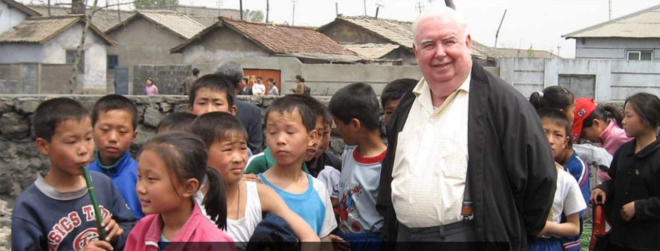 Maryknoll Father Gerard Hammond proudly stands with the North Korean people he serves with love.