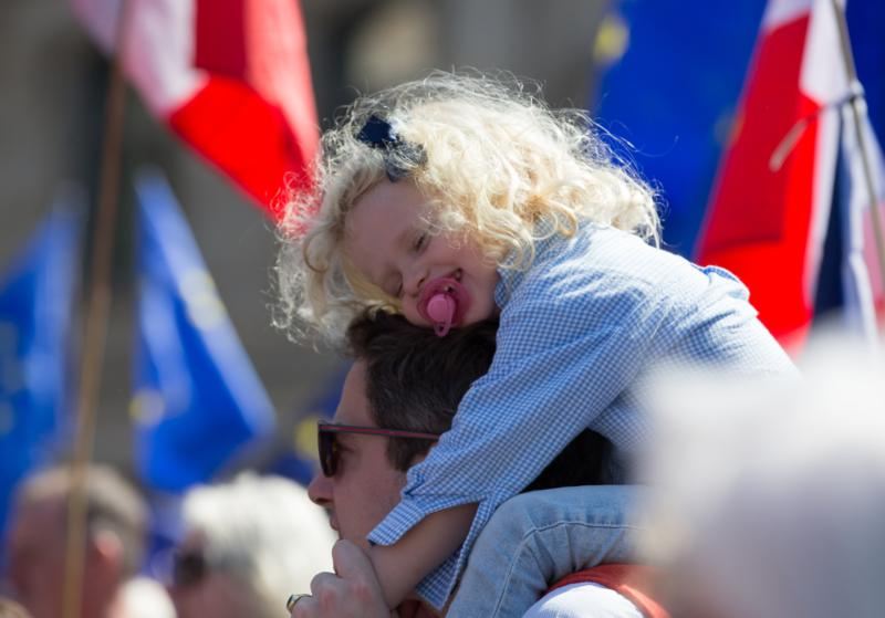 A girl smiles while sitting on the shoulders of her father April 9 in Goetheplatz Square in Frankfurt, Germany. As with any vocation, fatherhood is fundamentally not about the father himself, but about how he relates to others: as protector, defender and sanctifier of his family. (CNS photo/Alexander Becher, EPA) S