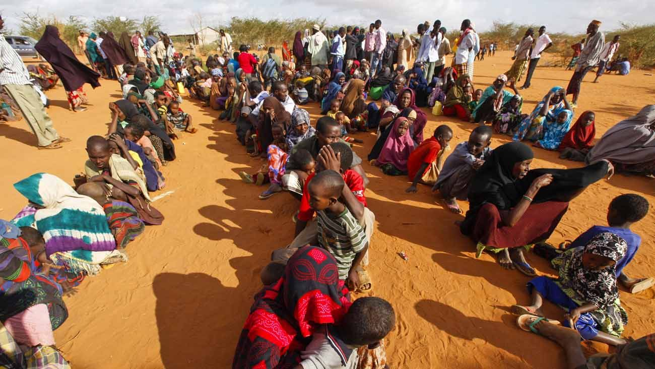 Somali refugees are seen after arriving in 2011 at a camp in Dadaab, Kenya.In Dadaab, the world's largest refugee complex in northeast Kenya, Somali refugees are facing the question of whether to return to their homeland or stay and risk being forced to move if the Kenyan government closes the camp. (CNS photo/Dai Kurokawa, EPA)