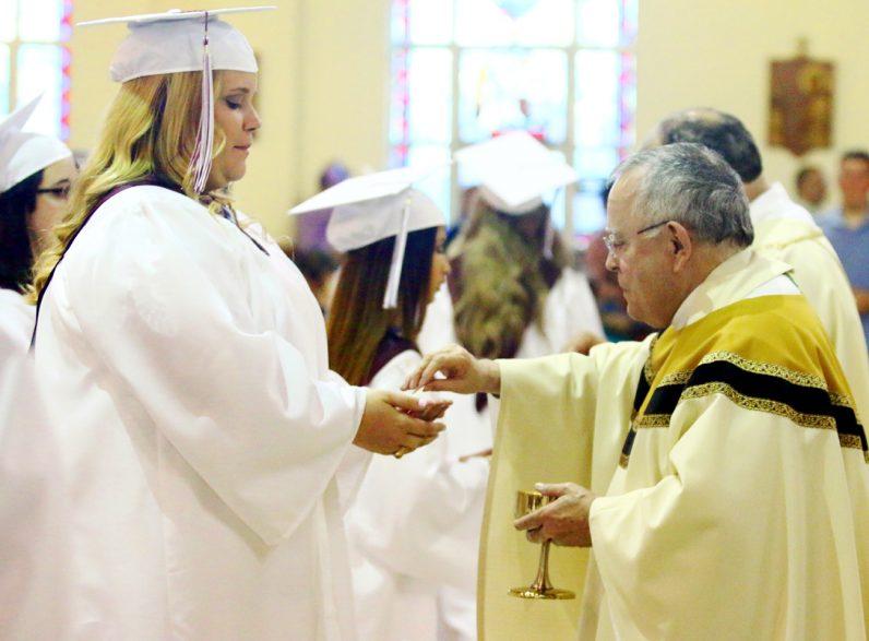 Alexandria Iannacone receives holy Communion from Archbishop Charles Chaput.