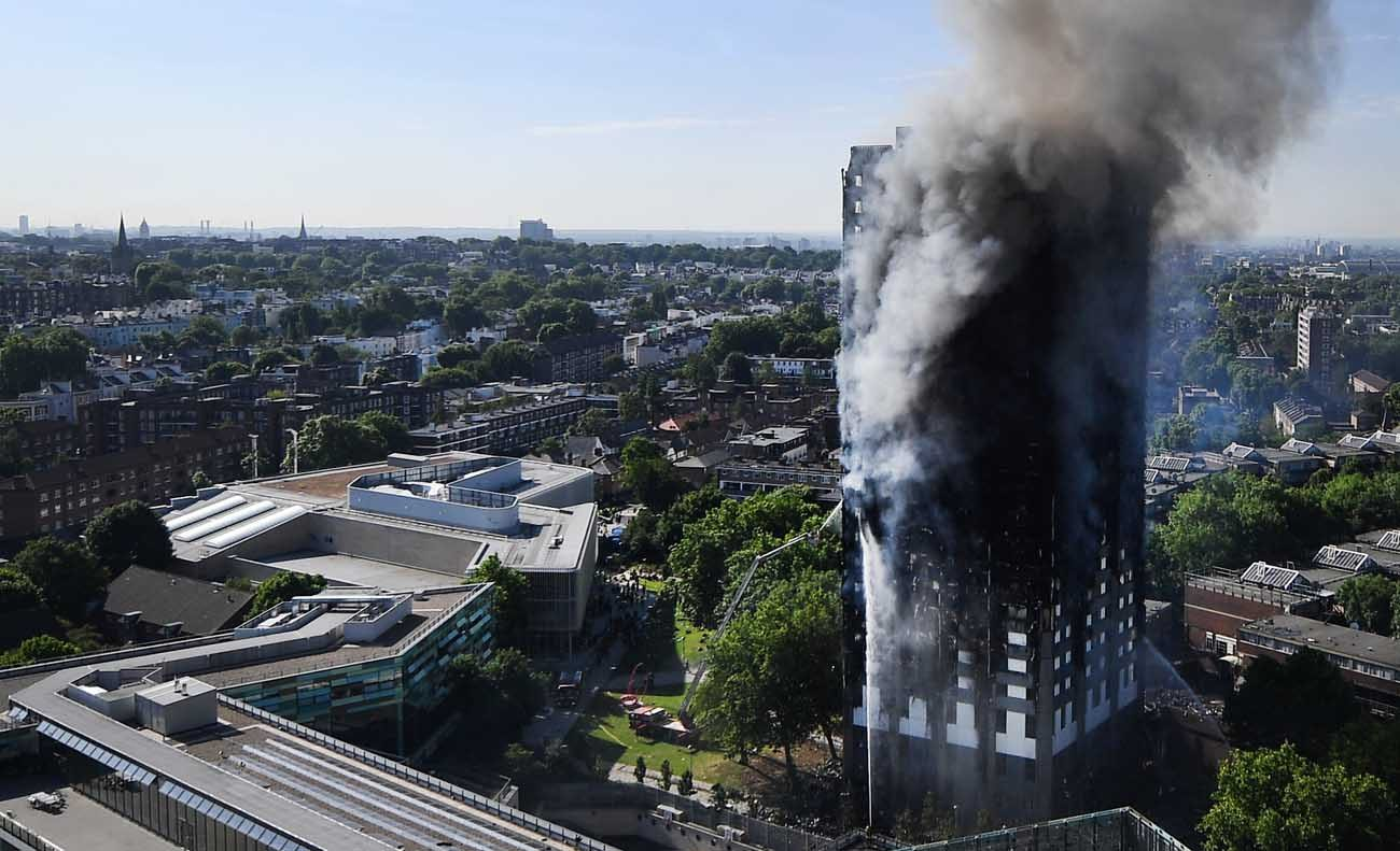 Flames and smoke billow from a London apartment building  June 14. London's Metropolitan Police said a number of people were being treated for a range of injuries, and authorities appealed for families to report anyone unaccounted for. (CNS photo/Andy Rain, EPA)