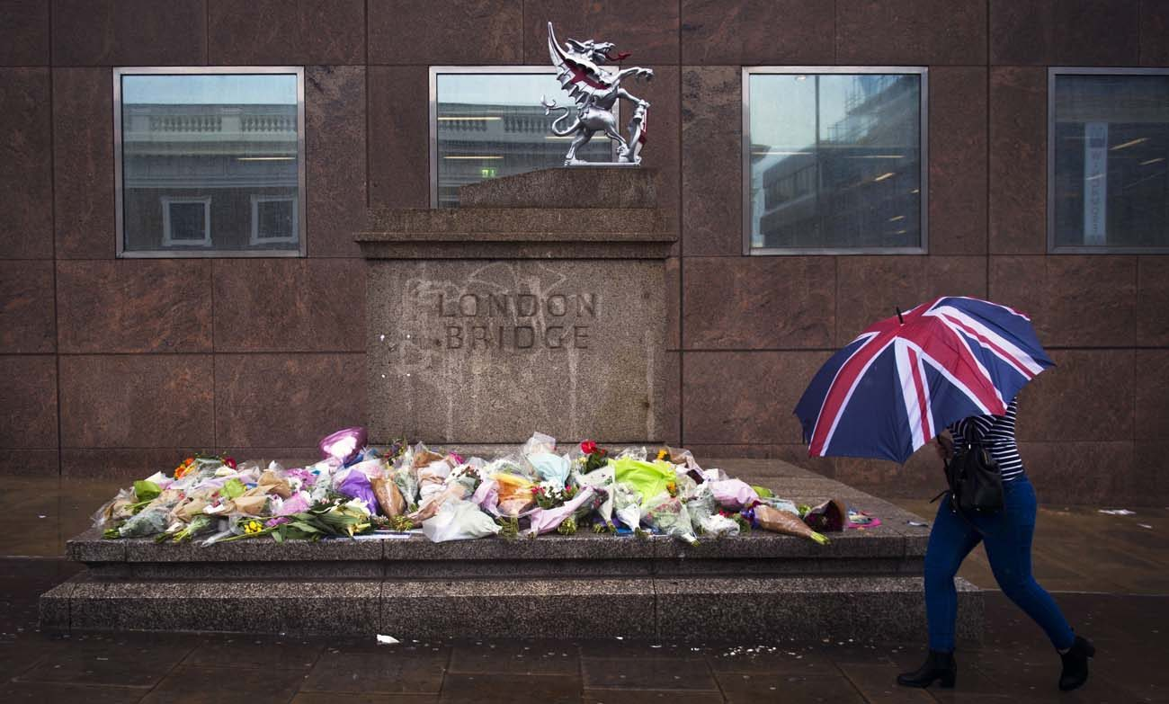 A person walks past a memorial for victims of the London Bridge terror attacks  in London, June 6. Archbishop Peter Smith of Southwark, the archdiocese that covers London south of the River Thames, offered prayers for the victims, survivors and first responders. (CNS photo/Will Oliver, EPA)