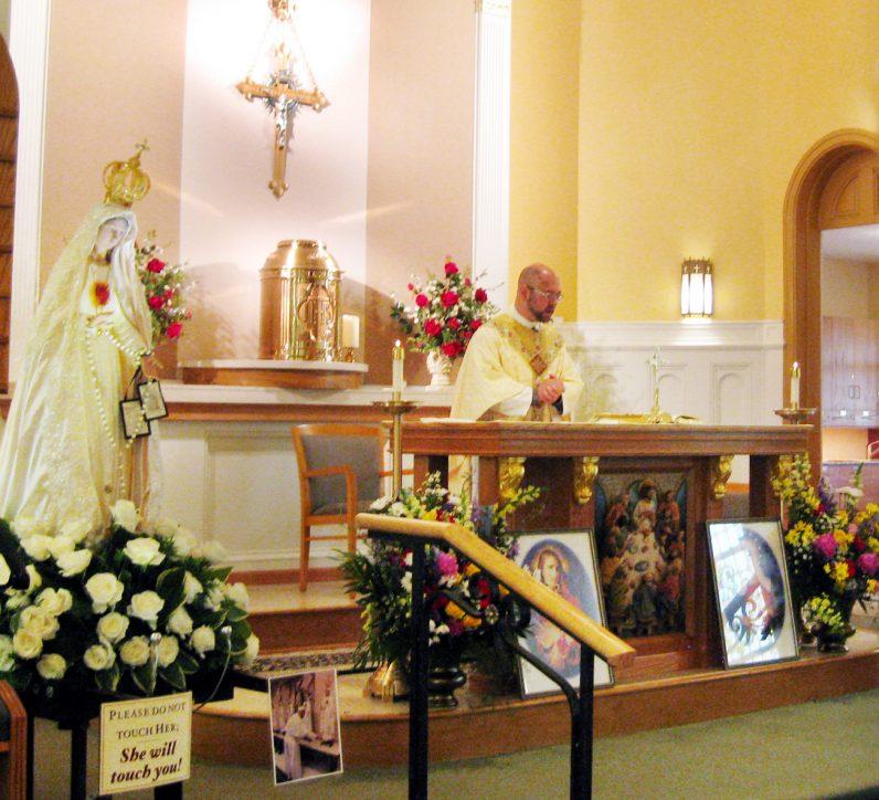 Father Alan Okon, pastor of St. Francis de Sales Parish, celebrates Mass June 16.