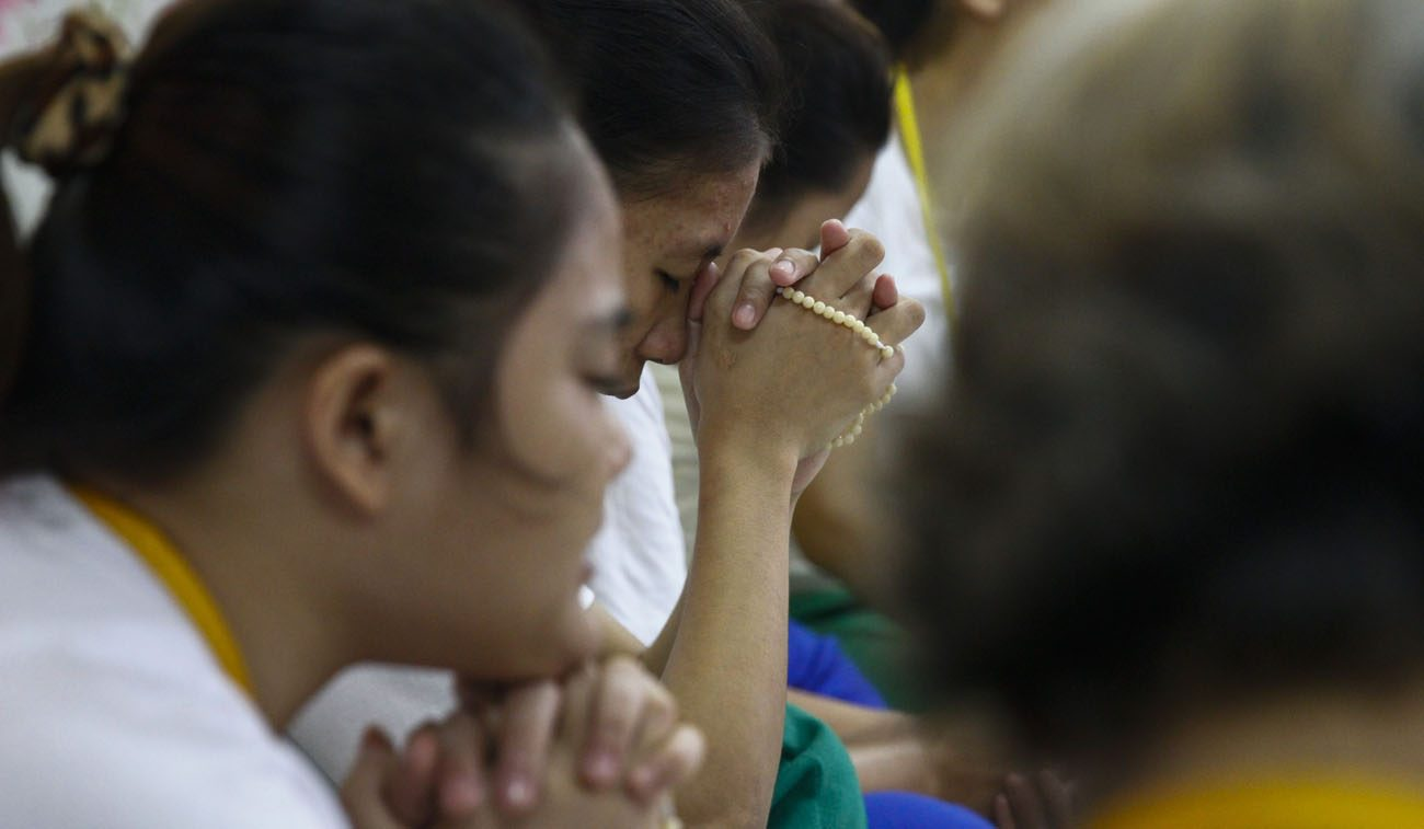 """Filipinos in a drug rehabilitation program pray in Manila. The Catholic Bishops' Conference of the Philippines has been critical of President Rodrigo Duterte's administrations """"war on drugs"""" and says it has received pushback with fake news on social media. (CNS photo/Rolex Dela Pena, EPA)"""