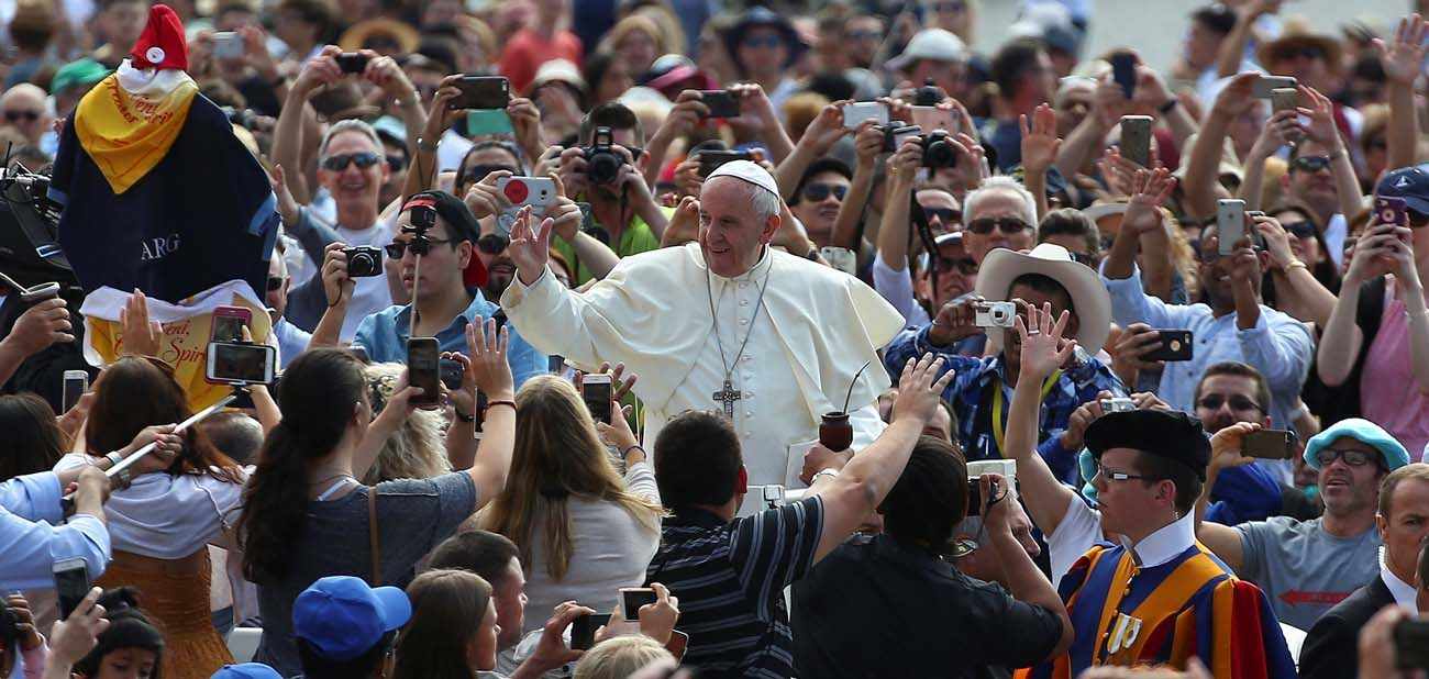 Pope Francis waves as he arrives for his general audience June 7 in St. Peter's Square at the Vatican. (CNS/Alessandro Bianchi, Reuters)