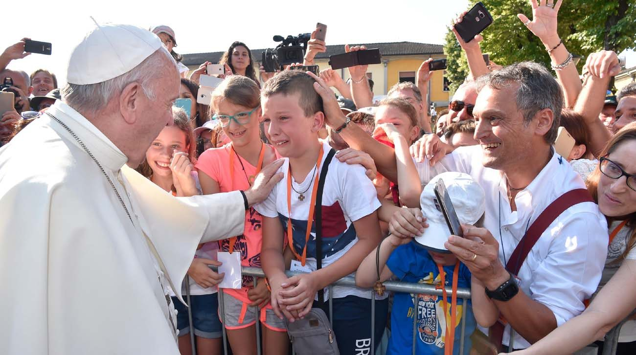 A boy becomes emotional as Pope Francis arrives to visit the tomb of influential 20th century Italian Father Primo Mazzolari June 20 at St. Peter the Apostle Church in Bozzolo, Italy. (CNS photo/L'Osservatore Romano)