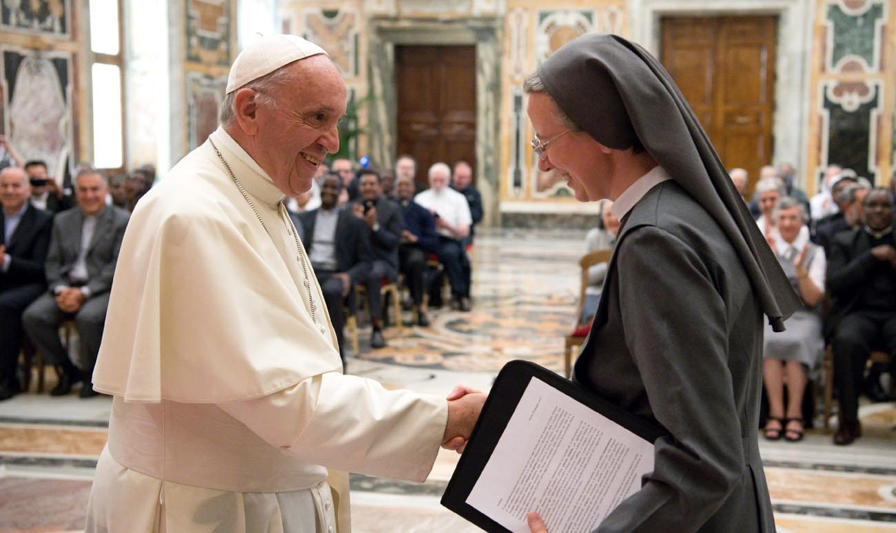 Pope Francis greets Consolata Sister Simona Brambilla, superior general of the Consolata Missionary Sisters, during a June 5 audience with the men's and women's branches of the religious missionary congregation. (CNS photo/L'Osservatore Romano)