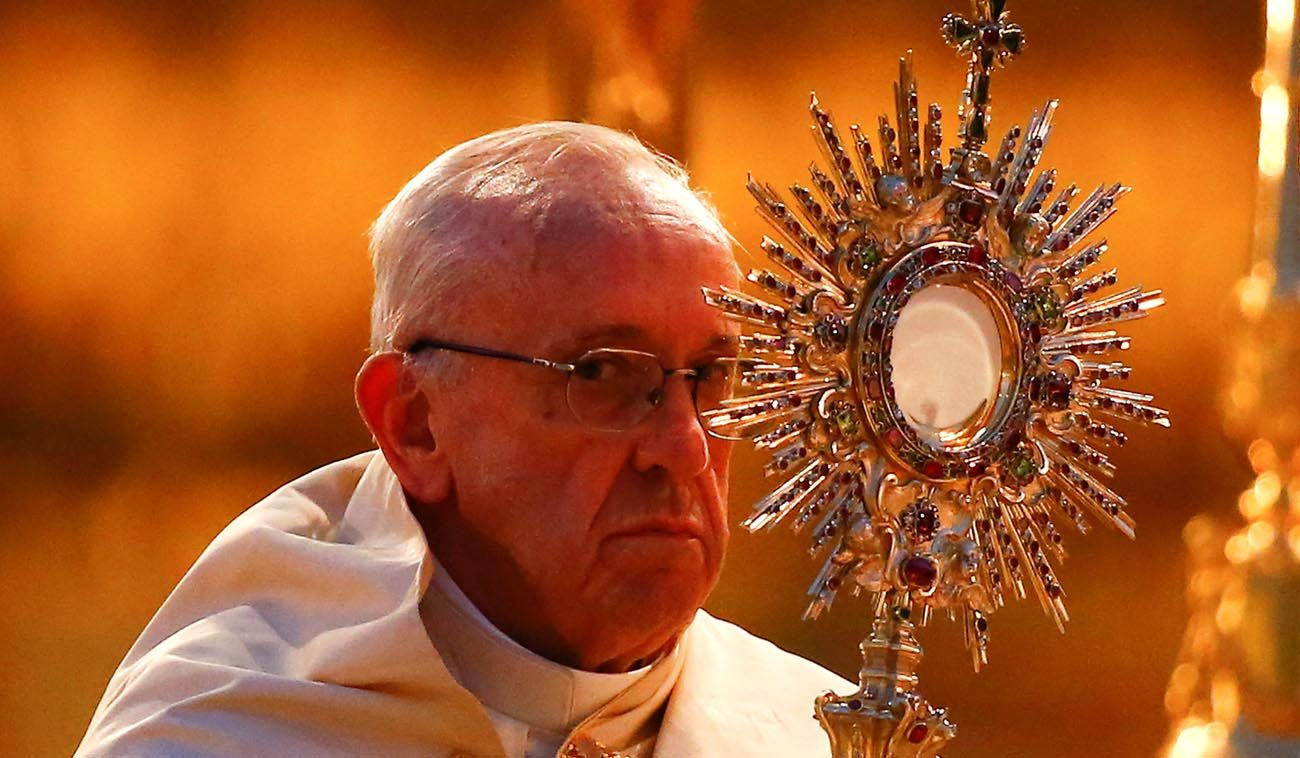 Pope Francis holds a monstrance on the feast of Corpus Christi June 18 at Rome's Basilica of St. Mary Major. (CNS/Tony Gentile, Reuters)