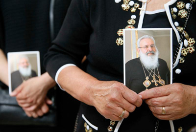 A woman holds an image of Ukrainian Cardinal Lubomyr Husar during his June 5 funeral Mass at the Patriarchal Cathedral of the Resurrection of Christ in Kiev. Cardinal Husar died May 31 at the age of 84. (CNS/Valentyn Ogirenko, Reuters)