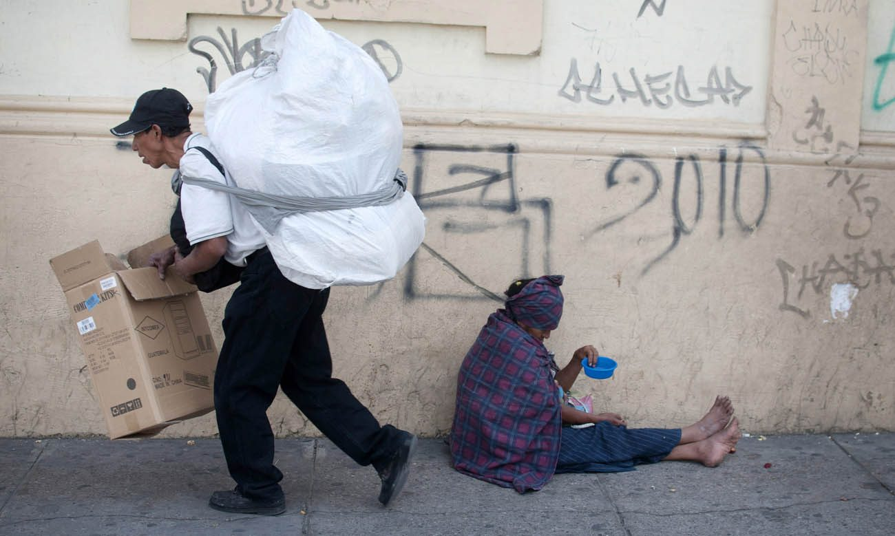 A woman begs for money in Guatemala City in this 2011 file photo. (CNS photo/Saul Martinez)