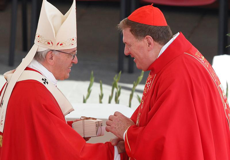 Pope Francis presents a box containing a pallium to Cardinal Joseph W. Tobin of Newark, N.J., at the conclusion of Mass marking the feast of Sts. Peter and Paul in St. Peter's Square at the Vatican June 29. New archbishops from around the world received their palliums from the pope. The actual imposition of the pallium will take place in the archbishop's archdiocese. (CNS photo/Paul Haring)