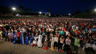 People attend a Mass at the worldwide jubilee gathering marking the 50th anniversary of the Catholic charismatic renewal at the Circus Maximus in Rome June 2. (CNS photo/Paul Haring)