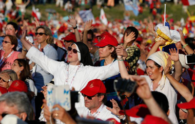 People sing as Pope Francis leads a Pentecost vigil marking the 50th anniversary of the Catholic Charismatic Renewal at the Circus Maximus in Rome June 3. (CNS photo/Paul Haring)