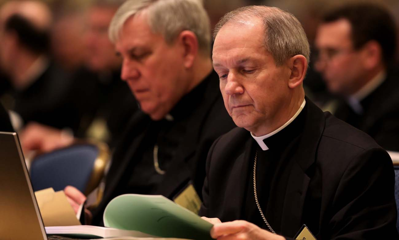 Bishop Thomas J. Paprocki of Springfield, Ill., looks over papers  during the annual fall general assembly of the U.S. Conference of Catholic Bishops in Baltimore in this Nov. 10, 2014, file photo. (CNS photo/Bob Roller)
