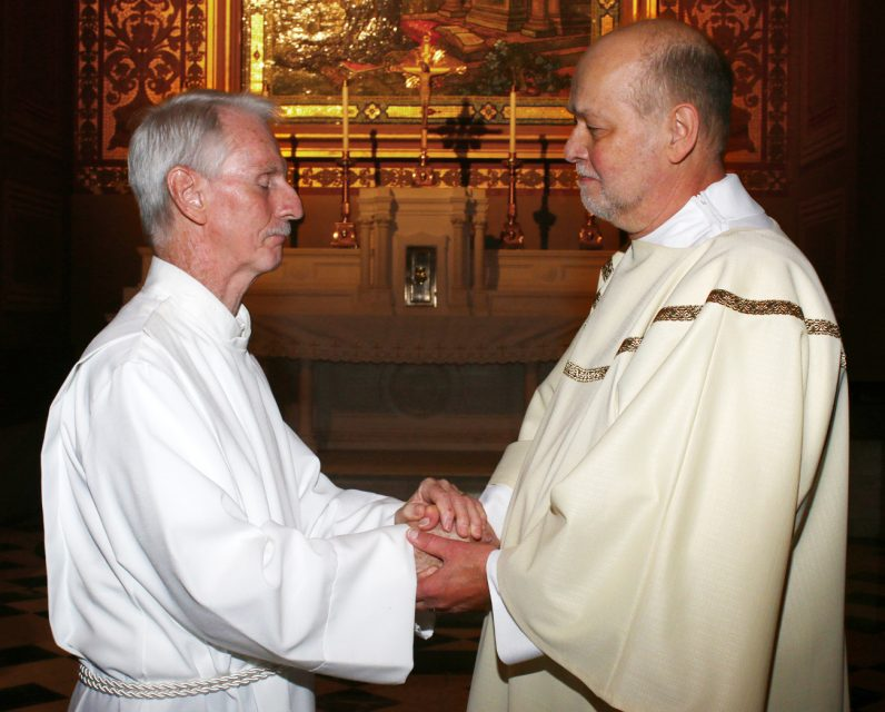 Joe Murphy, left, congratulates his friend Jack Pfeifer on his ordination to the permanent diaconate June 10 at the Cathedral Basilica of SS. Peter and Paul, Philadelphia. (Sarah Webb)