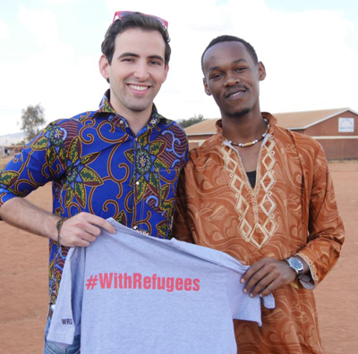 Joe Slaven, head of global operations for Jesuit Worldwide Learning, poses in 2016 with diploma student Pascal Biko at Dzaleka Refugee Camp in Malawi. (CNS photo/courtesy Jesuit Worldwide Learning)
