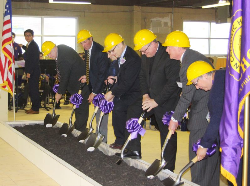 Roman Catholic High School officials ceremonially break ground on the new Howard Center for the Arts on Tuesday, May 30. The center is part of a long-term campus expansion plan.