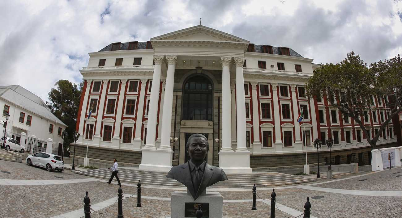 A statue of Nelson Mandela is seen in early April outside the South African Parliament building in Cape Town. Following findings of severe corruption in government, the South African Council of Churches called for the dissolving of parliament and new general elections. (CNS photo/Nic Bothma, EPA)
