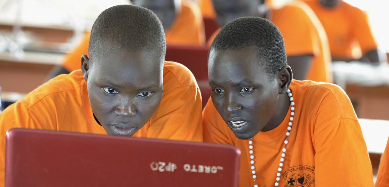Students work in a computer class in late April at Loreto Girls Secondary School in Rumbek, South Sudan. The school brings girls from throughout this ethnically diverse country to study and learn together. (CNS photo/Paul Jeffrey)