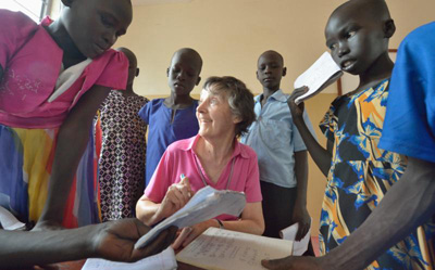 Irish Loreto Sister Rosemary Gallagher, who teaches at Loreto Primary School in Rumbek, South Sudan, works with students in late April. (CNS photo/Paul Jeffrey)