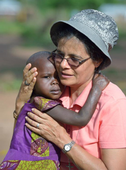 Sister Raquel Peralta of Paraguay embraces a girl in a camp for more than 5,000 displaced people in Riimenze, South Sudan.  (CNS photo/Paul Jeffrey)