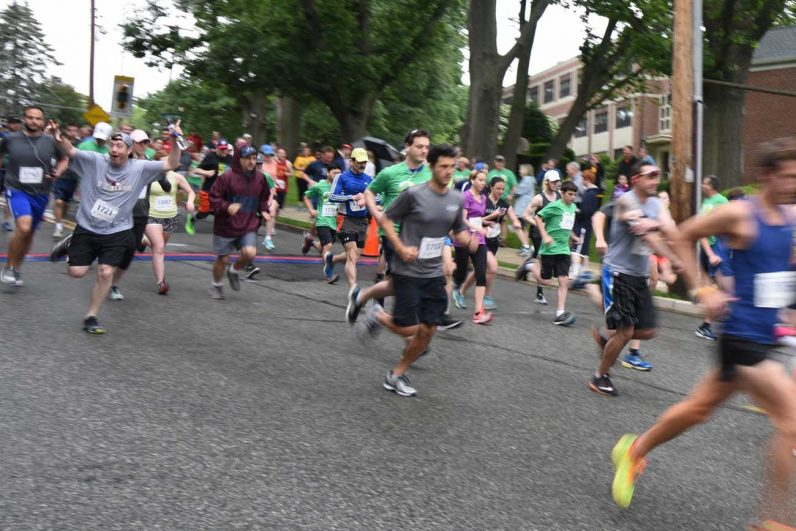 The runners in St. Dot's Challenge begin their 5K trek through Drexel Hill.