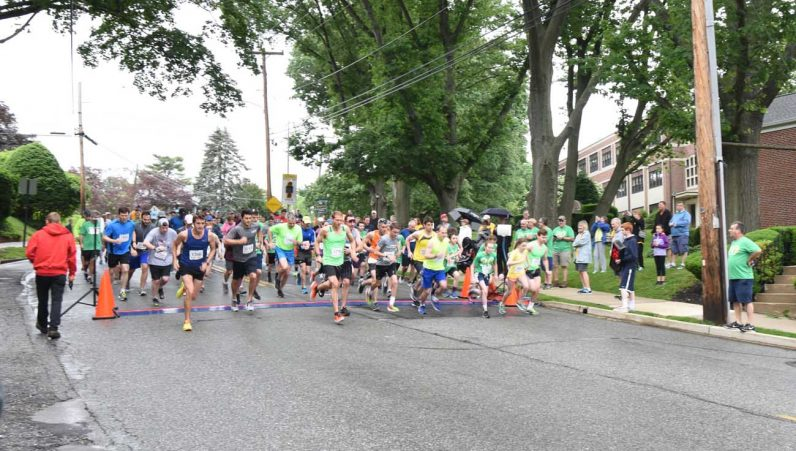 Runners in the St. Dot's Challenge, a 5K race benefiting the Delaware County parish and other community programs, head out from the starting line through the neighborhoods of Drexel Hill on Saturday, June 3. (Stephanie Perea)
