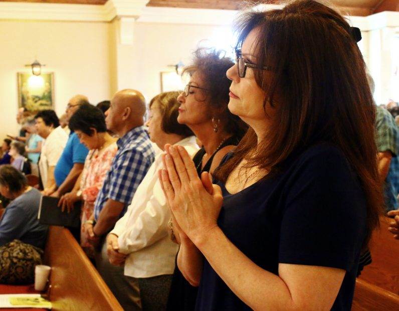 People pray during Mass at St. Bede church on Sunday, June 25.