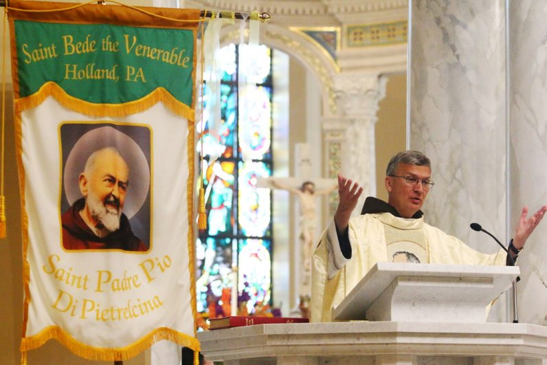 Franciscan Father Tom Betz preaches the homily during the 12:30 p.m. Mass at St. Bede Church during the Padre Pio Festival.