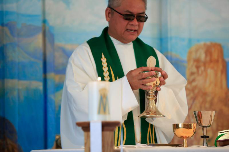 "Father Rafael Bercasio celebrates Mass at El Cristo Rey Chapel in Grand Canyon National Park in Arizona. ""Even on vacation, faith does not take a rest. And it is a good feeling to see tourists come to receive the sacraments,"" says Father Bercasio. (CNS photo/Nancy Wiechec)"