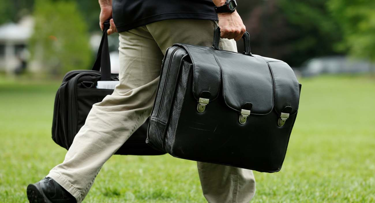 An aide carries a case containing launch codes for nuclear weapons in Washington while following President Donald Trump before his departure to Camp David June 17. (CNS photo/Yuri Gripas, Reuters)