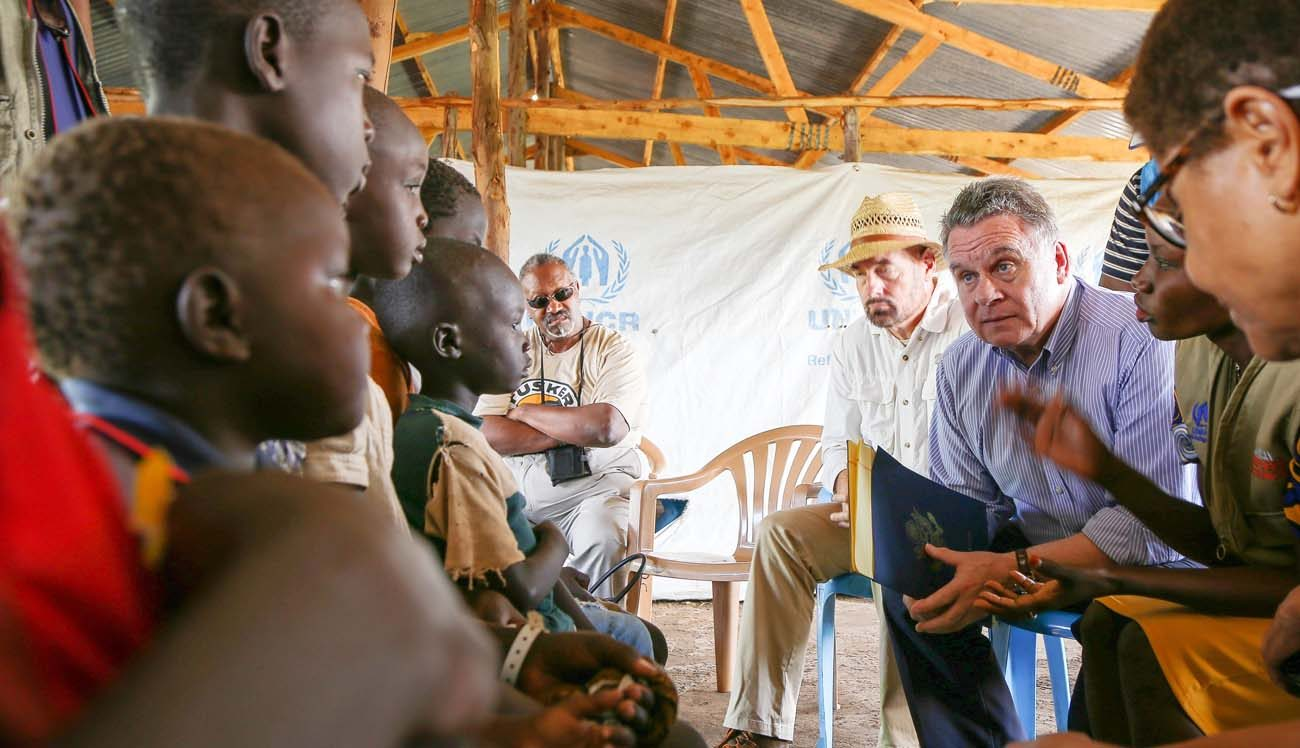 Rep. Chris Smith, R-N.J., speaks May 29 with children who, along with members of their family, have fled South Sudan for safety at the Bidi Bidi refugee camp in Arua, Uganda. (CNS photo/Helen Manson, U.S. Embassy in Uganda) .
