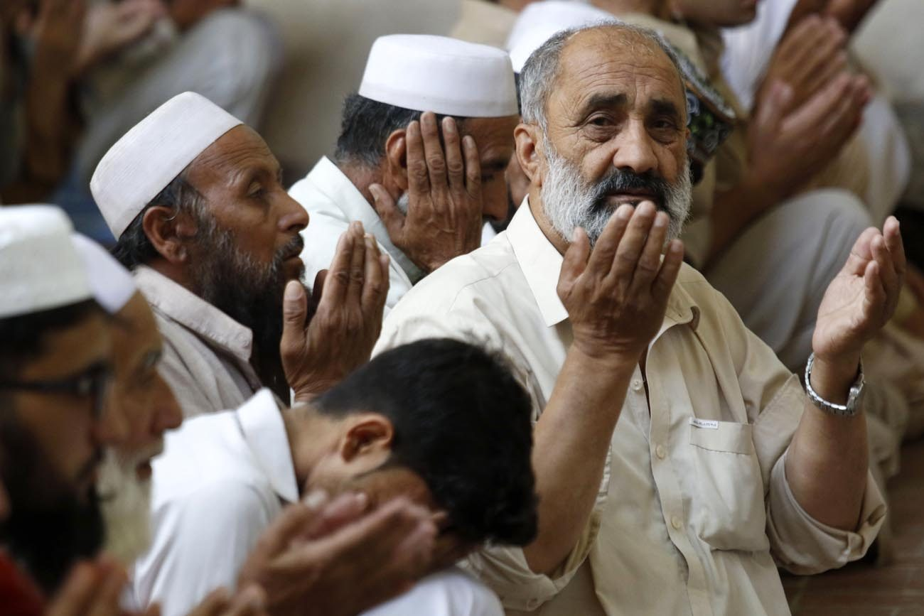 Pakistani Muslims men attend the first Friday prayer of the holy fasting month of Ramadan June 2 in Peshawar. Safeguarding creation is a religious obligation, Vatican officials said in their annual Ramadan message. (CNS photo/Bilawal Arbab, EPA)