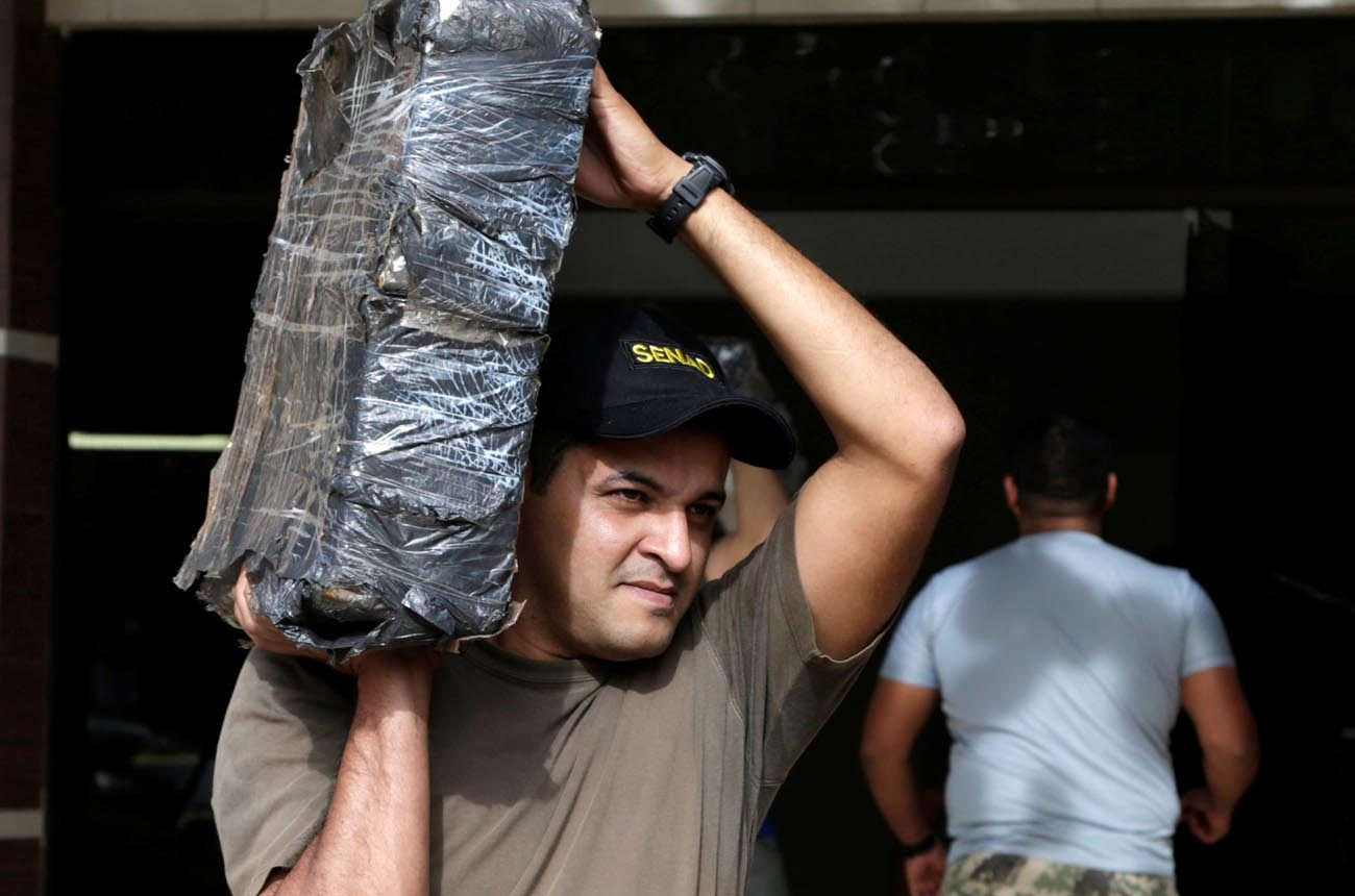 A soldier from Paraguay's National Anti-Drug Secretariat carries a package of evidences June 15 after following an operation that led to the seizure of marijuana in Asuncion. (CNS photo/Jorge Adorno, Reuters)