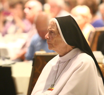"Mother Assumpta Long, who led a panel of her Michigan-based Dominican Sisters of Mary, Mother of the Eucharist in a discussion on the catechism's ""Christian Prayer"" pillar at the conference, listens to a speaker. (Sarah Webb)"