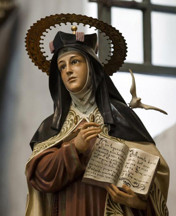 A statue of St. Teresa of Avila, Spanish mystic and doctor of the church, stands in the sanctuary of the Serra Chapel at Mission San Juan Capistrano in San Juan Capistrano, Calif. We are all called to be mystics on some level. God is present to us and desires us. (CNS photo/Nancy Wiechec)